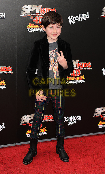 "Mason Cook.The World Premiere of ""Spy Kids: All the Time in the World in 4D"" held at The Regal Cinames, L.A. Live in Los Angeles, California, USA..July 31st, 2011.full length black jacket jeans denim hand v peace sign.CAP/ROT/TM.©Tony Michaels/Roth Stock/Capital Pictures"