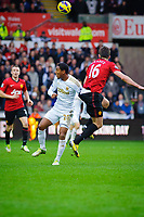 Sunday, 23 November 2012<br /> <br /> Pictured: Jonathan de Guzman of Swansea City and Michael Carrick of Manchester United<br /> <br /> Re: Barclays Premier League, Swansea City FC v Manchester United at the Liberty Stadium, south Wales.