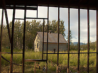 An old building is outlined by the framework of another at Fortymile City, located at the confluence of the Fortymile River and the Yukon River, about 50 miles from the border between Canada and Alaska.