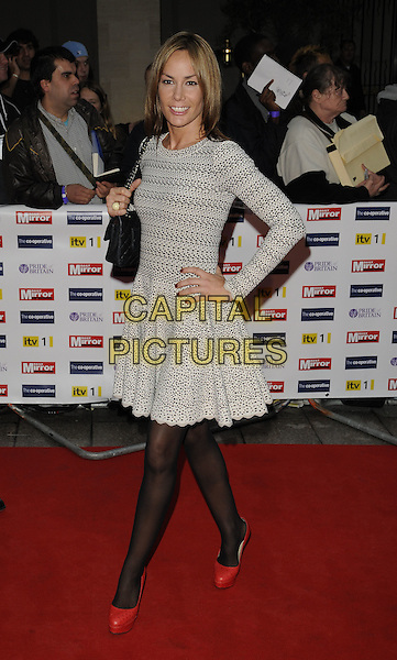 TARA PALMER TOMKINSON.The Pride of Britain Awards, Grosvenor House, Hotel, Park lane, London, England..October 5th, 2009.full length tpt black tights orange red platform shoes black bag purse hand on hip lace white crochet dress perforated  cut out .CAP/CAN.©Can Nguyen/Capital Pictures.