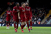 17th March 2019, Craven Cottage, London, England; EPL Premier League football, Fulham versus Liverpool; James Milner of Liverpool  celebrates with Georginio Wijnaldum and Mohamed Salah as he scores from the penalty spot for 1-2 in the 81st minute