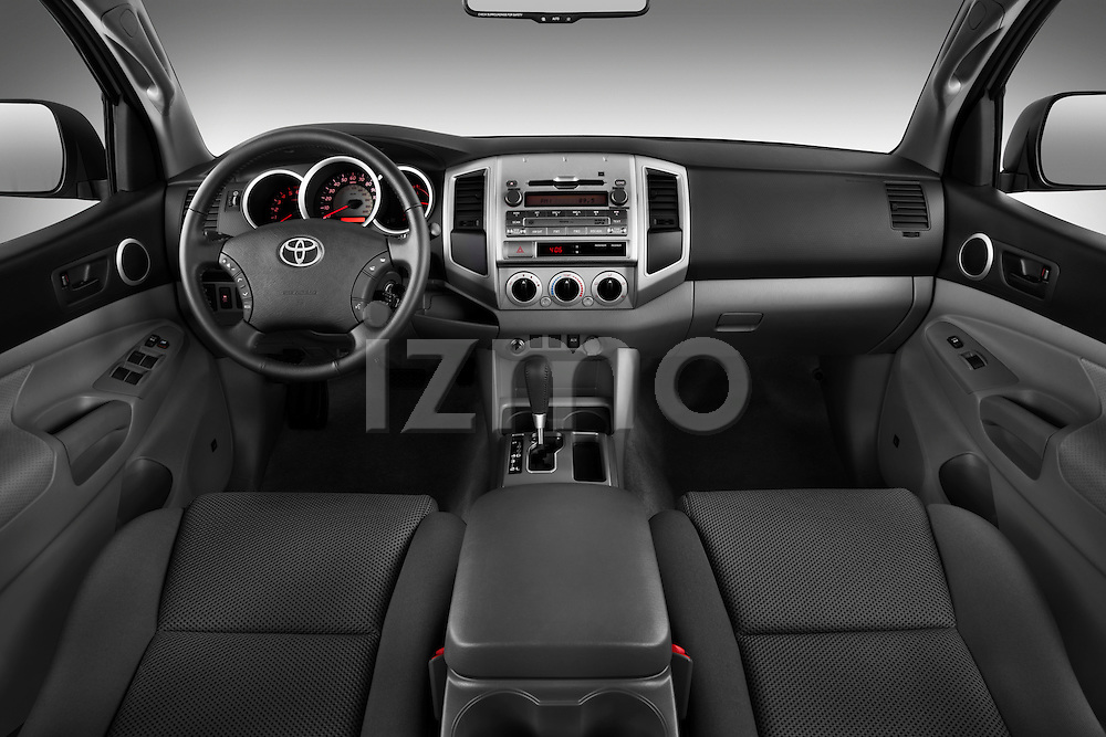 Straight dashboard view of a 2011 Toyota Tacoma PreRunner Off Road Double Cab