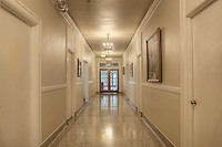 Long Hallway in Elegant Old Building.  Dating to 1927, the Masonic Retirement Center, locally known as the Masonic Home, in Des Moines, Washington is now an elegant event center available for rental.  In the historic Zenith neighborhood of the city of Des Moines. Please conact douglasorton@comcast.net regarding licensing of this image.