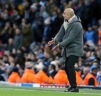 Manchester City manager Josep Guardiola shouts instructions to his team from the dug-out <br /> <br /> Photographer Rich Linley/CameraSport<br /> <br /> UEFA Champions League Round of 16 Second Leg - Manchester City v FC Schalke 04 - Tuesday 12th March 2019 - The Etihad - Manchester<br />  <br /> World Copyright © 2018 CameraSport. All rights reserved. 43 Linden Ave. Countesthorpe. Leicester. England. LE8 5PG - Tel: +44 (0) 116 277 4147 - admin@camerasport.com - www.camerasport.com