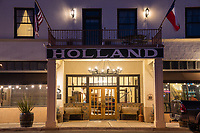 The Holland Hotel at night  in downtown Alpine Texas.