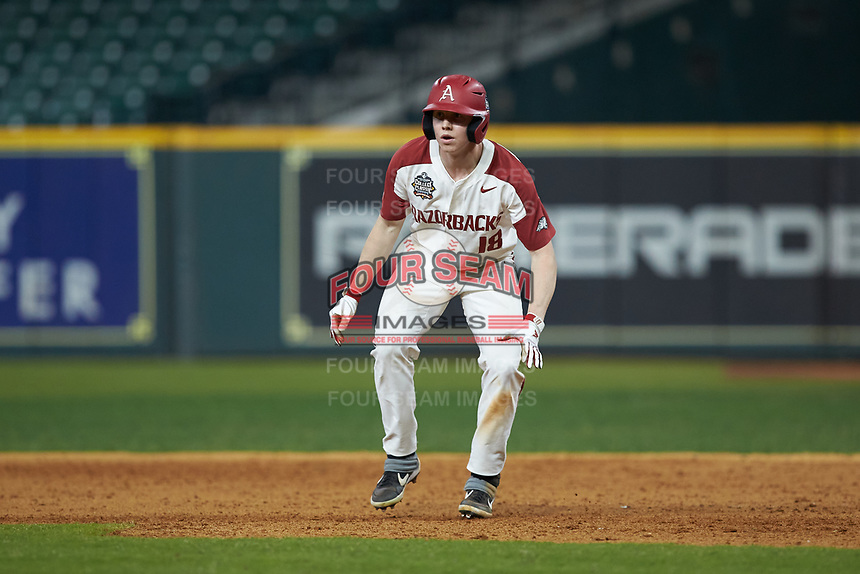 Heston Kjerstad (18) of the Arkansas Razorbacks takes his lead off of first base against the Baylor Bears in game nine of the 2020 Shriners Hospitals for Children College Classic at Minute Maid Park on March 1, 2020 in Houston, Texas. The Bears defeated the Razorbacks 3-2. (Brian Westerholt/Four Seam Images)