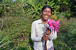 Outh Sa poses with water lilies she has harvested from her pond in the village of Dong in northern Cambodia. Life With Dignity, a member of the ACT Alliance, is working with people in this village to increase their agricultural production and thus increase food security.