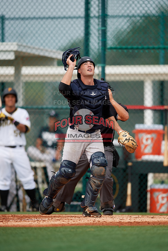 GCL Yankees East catcher Alex Guerrero (49) tracks a pop up during the first game of a doubleheader against the GCL Pirates on July 31, 2018 at Pirate City Complex in Bradenton, Florida.  GCL Yankees East defeated GCL Pirates 2-0.  (Mike Janes/Four Seam Images)