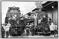 Just before Big Boy's departure from the Duluth Depot, engines 4014 and 332 stopped for a photo op, side-by-side. After most participants exited the large group photo, I enjoyed this moment when Ed Dickens (4014 Engineer) and John Stein (332 Engineer) shook hands. There were handshakes and pats-on-the-back among crew members on the ground too -- the genuine camaraderie was palpable. The Union Pacific Big Boy 4014 was built in 1941 and the Duluth, Missabe & Iron Range 332 (formerly Duluth & Northeastern 28) was built in 1906, so there was a lot of steam engine history on the rails by The Depot!