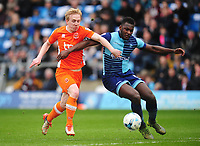 Blackpool's Mark Cullen vies for possession with Wycombe Wanderers' Aaron Pierre<br /> <br /> Photographer Kevin Barnes/CameraSport<br /> <br /> The EFL Sky Bet League Two - Wycombe Wanderers v Blackpool - Saturday 11th March 2017 - Adams Park - Wycombe<br /> <br /> World Copyright &copy; 2017 CameraSport. All rights reserved. 43 Linden Ave. Countesthorpe. Leicester. England. LE8 5PG - Tel: +44 (0) 116 277 4147 - admin@camerasport.com - www.camerasport.com