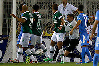 Futbol, O'Higgins vs Deportivo Cali.<br /> SANTIAGO-CHILE -19-02-2014. El jugador de O'Higgins Yerzon Opazo, fuera de la foto, marca su gol contra Deportivo Cali durante el partido de segunda fase, grupo 3 de la Copa Libertadores de America disputado en el estadio Monumental de Santiago, Chile./ O'Higgins player Yerzon Opazo, out of the picture, scores against Deportivo Cali during the second phase, group 3 of the Copa Libertadores championship football match held at Monumental stadium in Santiago, Chile.   Photo: VizzorImage/ Andres Pina /Photosport
