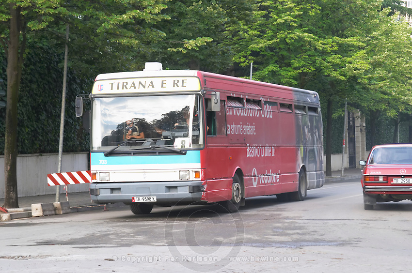 A city bus with publicity for Vodafone on the boulevard Bulevardi Deshmoret e Kombit. Tirana capital. Albania, Balkan, Europe.