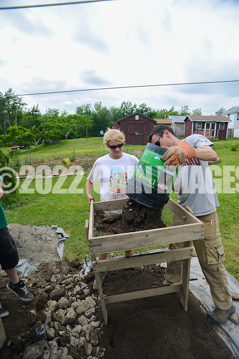 HAZLETON, PA - JUNE 30:  Camille Westmont (L) and Mike Roller (R) work at the site of an archaeologic dig June 30, 2014 in Hazleton, Pennsylvania. The team is looking through sites connected with the Lattimer Massacre which occurred in 1897. (Photo by William Thomas Cain/Cain Images)