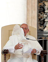 Papa Francesco tiene l'udienza generale del mercoledi' in Piazza San Pietro, Citta' del Vaticano, 26 giugno 2013.<br /> A gust of wind moves Pope Francis' mantle, during his weekly general audience in St. Peter's Square at the Vatican, 26 June 2013.<br /> UPDATE IMAGES PRESS/Isabella Bonotto<br /> <br /> STRICTLY ONLY FOR EDITORIAL USE