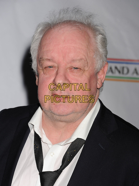 Jim Sheridan.The US-Ireland Alliance Pre-Academy Awards Gala Held At Bad Robot, Santa Monica, California, USA..February 21st, 2013.headshot portrait black suit white shirt .CAP/ROT/TM.©Tony Michaels/Roth Stock/Capital Pictures