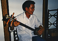 Musician playing a home made string instrument in Guilin, China