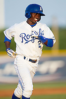 D.J. Burt (2) of the Burlington Royals is all smiles as he round the bases after hitting his first professional home run against the Greeneville Astros at Burlington Athletic Park on June 30, 2014 in Burlington, North Carolina.  The Royals defeated the Astros 9-8. (Brian Westerholt/Four Seam Images)