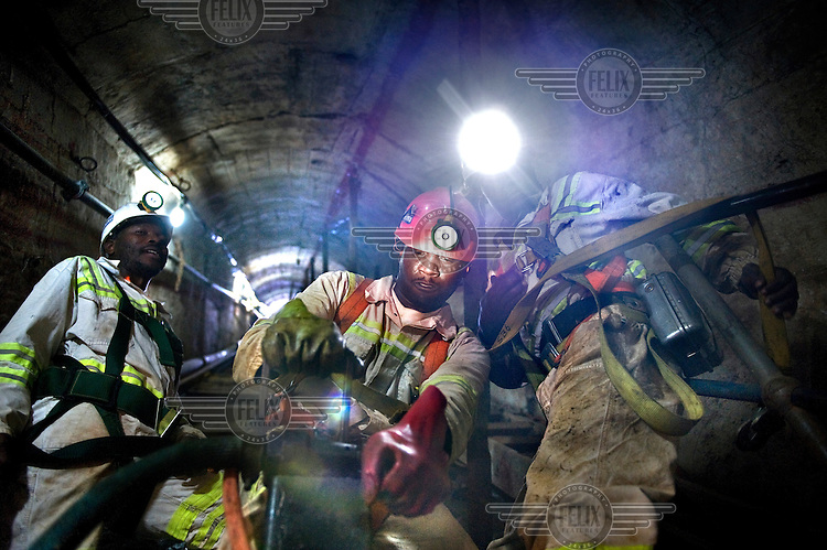 Miners in a recently re-opened gold mine, re-opened to take advantage of the increased global price of gold following the economic crash.