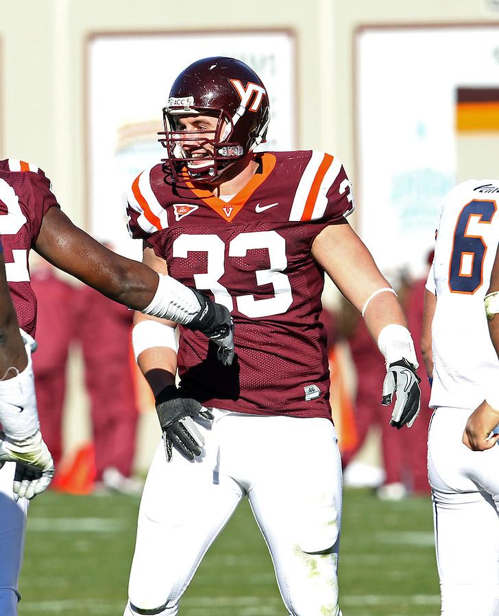 Nov 27, 2010; Charlottesville, VA, USA;  Virginia Tech Hokies defensive end Chris Drager (33) during the game at Lane Stadium. Virginia Tech won 37-7. Mandatory Credit: Andrew Shurtleff
