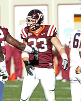 Nov 27, 2010; Charlottesville, VA, USA;  Virginia Tech Hokies defensive end Chris Drager (33) during the game at Lane Stadium. Virginia Tech won 37-7. Mandatory Credit: Andrew Shurtleff