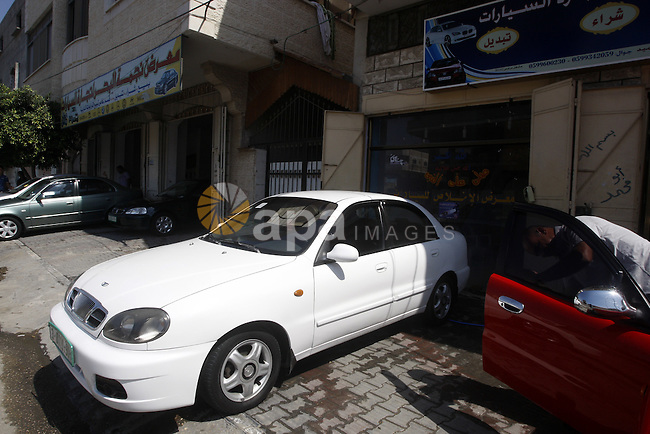 A Palestinian man inspects the cars, at a showroom in Gaza City on Sep. 7, 2011. while Israel stop to enter cars into Gaza Strip again after it allowed to enter them as a part of a new strategy to increase Gaza blockade. Photo by Mahmud Nassar