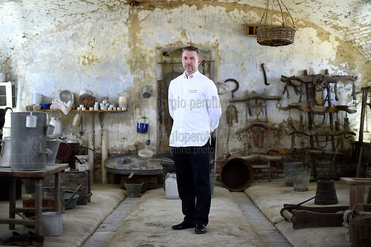 Franck Panier, Chef to the President of the Council of State of Luxembourg Victor Gillen, poses for a portrait in the Cascina Colombara during the annual meeting of the Club des Chefs des Chefs in Livorno Ferraris, Vercelli, Italy, July 18, 2015.<br /> The Club des Chefs des Chefs, which is seen as the world's most exclusive gastronomic society, has extremely strict membership criteria: to be accepted into this highly elite club, you need to be the current personal chef of a head of state. If he or she does not have a personal chef, members can be the executive chef of the venue that hosts official State receptions. One of the society's primary purposes is to promote major culinary traditions and to protect the origins of each national cuisine. The Club des Chefs des Chefs also aims to develop friendship and cooperation between its members, who have similar responsibilities in their respective countries. <br /> The annual meeting of the Club has been hosted this year in the production site of the Italian rice company called Riso Acquerello. <br /> © Giorgio Perottino