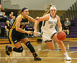 SIOUX FALLS, SD - DECEMBER 7: Kaely Hummel #12 from the University of Sioux Falls drives against Meghan DuBois #10 from Concordia St. Paul during their game Friday night at the Stewart Center in Sioux Falls, SD. (Photo by Dave Eggen/Inertia)