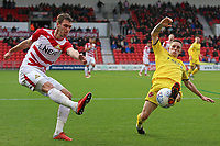 Fleetwood Town's Ashley Hunter blocks a clearance by Doncaster Rovers' Joe Wright<br /> <br /> Photographer David Shipman/CameraSport<br /> <br /> The EFL Sky Bet League One - Doncaster Rovers v Fleetwood Town - Saturday 6th October 2018 - Keepmoat Stadium - Doncaster<br /> <br /> World Copyright © 2018 CameraSport. All rights reserved. 43 Linden Ave. Countesthorpe. Leicester. England. LE8 5PG - Tel: +44 (0) 116 277 4147 - admin@camerasport.com - www.camerasport.com