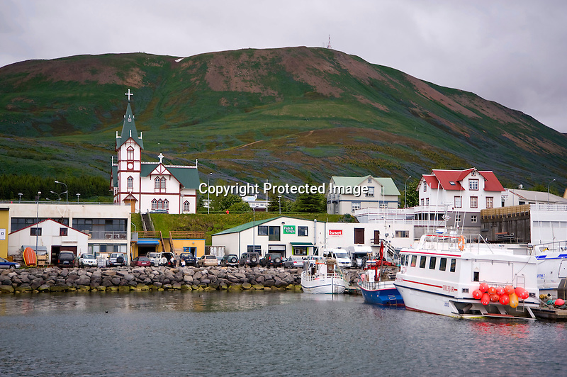 View of Harbor and Village and Church in Husavik in North Iceland