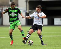 Pictured: Adnan Maric of Swansea (L) challenged by a Merthyr Town player Saturday 11 July 2015<br />