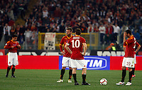 Calcio, Serie A: Roma vs Sampdoria. Roma, stadio Olimpico, 25 aprile 2010..Football, Italian serie A: Roma vs Sampdoria. Rome, Olympic stadium, 25 april 2010. From left, AS Roma's David Pizarro, Daniele De Rossi, Francesco Totti and Simone Perrotta react after Sampdoria forward Giampaolo Pazzini, not seen, scored..UPDATE IMAGES PRESS/Riccardo De Luca