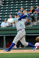 Center fielder Alfredo Escalera (21) of the Lexington Legends bats in a game against the Greenville Drive on Tuesday, April 14, 2015, at Fluor Field at the West End in Greenville, South Carolina. Lexington won, 5-3. (Tom Priddy/Four Seam Images)