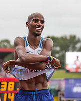 Mo FARAH of GBR takes off his shirt to hand to a fellow Brit as his says he is unlikely to race in a Great Britain shirt again during the Muller Grand Prix Birmingham Athletics at Alexandra Stadium, Birmingham, England on 20 August 2017. Photo by Andy Rowland.