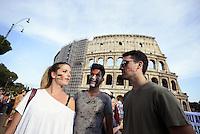 Roma 26 Luglio 2014<br /> Colosseo<br /> Presidio in solidariet&agrave; alla resistenza del popolo palestinese e contro l'offensiva militare israeliana nella Striscia di Gaza.<br /> La  protesta organizzata dalla comunit&agrave; dellee dei giovani palestinesi, &egrave; in concomitanza in tutta Europa e Mondo.<br /> Giovani con bandiere palestinesi disegnate sul viso.<br /> Rome July 26, 2014 <br /> Protest in solidarity with the resistance of the Palestinian people, and against the Israeli military offensive in the Gaza Strip.<br /> The protest was organized by the Palestinian youth, is at the same time throughout Europe and the World .