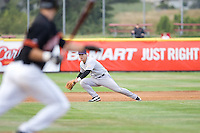 July 8, 2009: Tri-City Dust Devils third baseman Joseph Sanders makes a play on a slicing groundball during a Northwest League game against the Salem-Keizer Volcanoes at Volcanoes Stadium in Salem, Oregon.