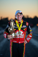 Nov 13, 2016; Pomona, CA, USA; NHRA top fuel driver Doug Kalitta poses for a portrait as he celebrates after winning the Auto Club Finals at Auto Club Raceway at Pomona. Mandatory Credit: Mark J. Rebilas-USA TODAY Sports