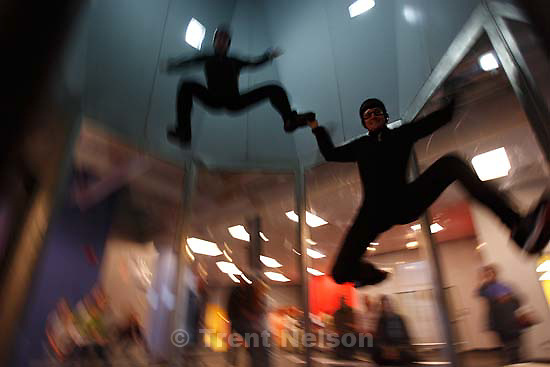 Ogden - Devin Roane (top) and Brett Parke float on air from a vertical wind tunnel at I Fly Utah, and Ogden attraction which gives people the feeling of skydiving