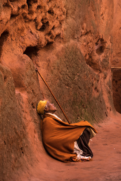 An elderly woman looks toward heaven to thank God for his provision (my small offering) in the outer courtyard at one of Lalibela's rock-hewn churches.