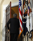 Washington, D.C. - March 19, 2007 -- United States President George W. Bush departs after making a statement marking the fourth anniversary of the start of the war in Iraq from the Roosevelt Room of the White House on Monday, March 19, 2007. <br /> Credit: Roger L. Wollenberg - Pool via CNP