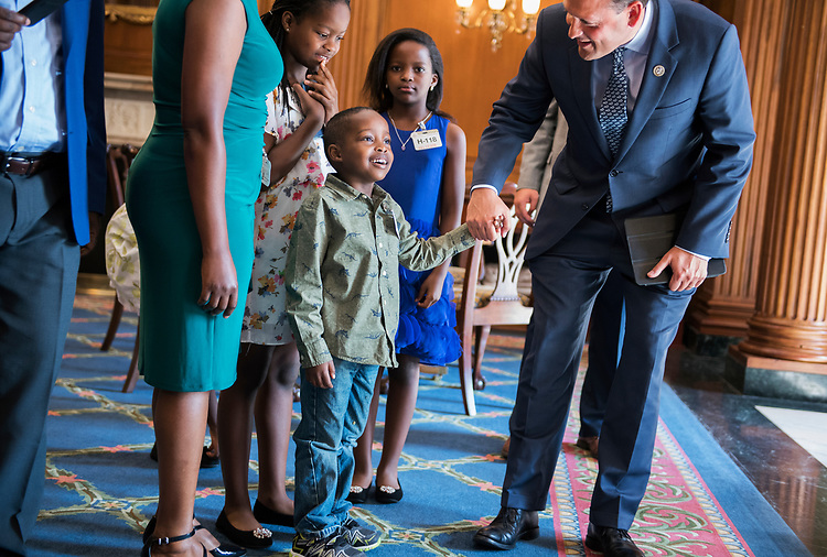 UNITED STATES - JULY 13: Rep. Andy Barr, R-Ky., gives a tour of Capitol's Rayburn Room on July 13, 2018, to constituent Alpha Fayida, 6, who was born in the U.S. and whose family, originally from Rwanda, recently became U.S. citizens. (Photo By Tom Williams/CQ Roll Call)