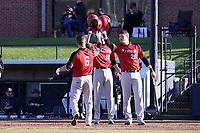 GREENSBORO, NC - FEBRUARY 25: Justin Guerrera #6 of Fairfield University celebrates his home run with teammates Dan Ryan #10 and Ian Halpin #26 during a game between Fairfield and UNC Greensboro at UNCG Baseball Stadium on February 25, 2020 in Greensboro, North Carolina.