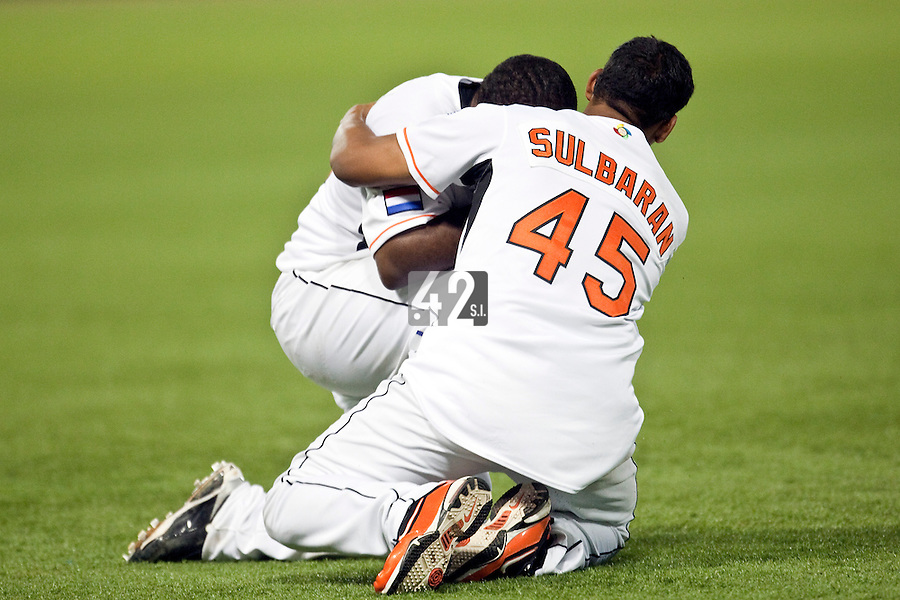10 March 2009: #45 Juan Carlos Sulbaran celebrates with #35 Randall Simon who cries after Netherlands beat Dominican Republic during the 2009 World Baseball Classic Pool D game 5 at Hiram Bithorn Stadium in San Juan, Puerto Rico. The Netherlands pulled off second upset to advance to the secound round. The Netherlands come from behind in the bottom of the 11th inning and beat the Dominican Republic, 2-1.