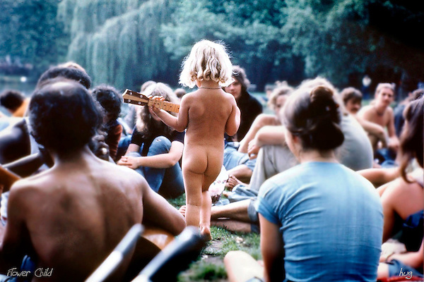 Nude young girl plays guitar