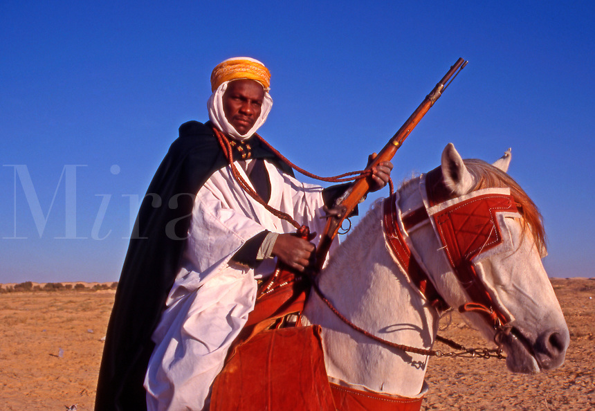 Horse rider at the Douz Desert Festival..Tunisia. North Africa.