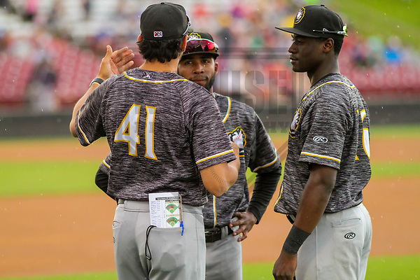 Quad Cities River Bandits outfielder Daz Cameron (16), infielder Osvaldo Duarte (18) and development coach Jason Bell (41) during a Midwest League game against the Wisconsin Timber Rattlers on June 8, 2017 at Fox Cities Stadium in Appleton, Wisconsin.  Wisconsin defeated Quad Cities 8-3. (Brad Krause/Krause Sports Photography)