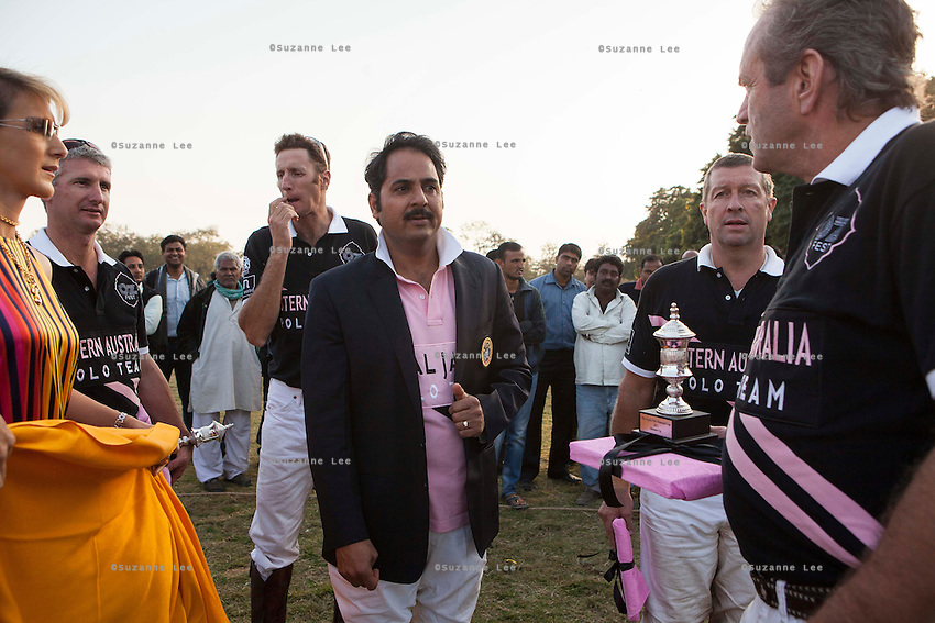 Maharaj Narendra Singh, captain of the Royal Jaipur Polo Team share a light conversation with the visiting polo team after the Argyle Pink Diamond Cup, organised as part of the 2013 Oz Fest in the Rajasthan Polo Club grounds in Jaipur, Rajasthan, India on 10th January 2013. Photo by Suzanne Lee