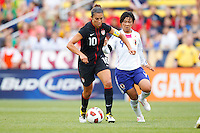 14 MAY 2011: USA Women's National Team midfielder Carli Lloyd (10) dribbles the ball past Japan National team Shinobu Ohno during the International Friendly soccer match between Japan WNT vs USA WNT at Crew Stadium in Columbus, Ohio.