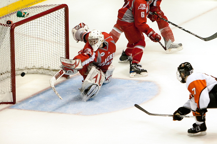March 20, 2010 - Rochester Institute of Technology's Bryan Potts from Ontario, Canada, right, scores on Sacred Heart's goaltender Steven Legatto at the Blue Cross Arena in Rochester, NY. RIT won 6-1.