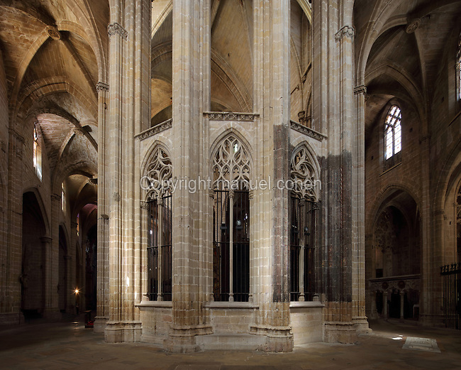 Apse, with surrounding ambulatory, in the Cathedral of St Mary, designed by Benito Dalguayre in Catalan Gothic style and begun 1347 on the site of a Romanesque cathedral, consecrated 1447 and completed in 1757, Tortosa, Catalonia, Spain. The cathedral has 3 naves with chapels between the buttresses and an ambulatory with radial chapels. Picture by Manuel Cohen