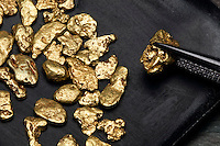 PLACER GOLD NUGGETS<br /> Native Gold<br /> (Variations Available)<br /> Gold nuggets from the Circle Mining District, Alaska. Gold particles are usually prone to welding together naturally under pressure from water and rocks. Gold is highly ductile and malleable.